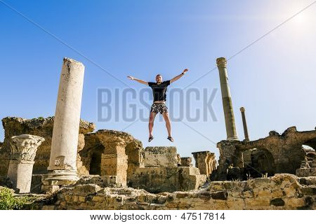 The Man In The Jump Amid The Ruins Of Carthage In Tunisia