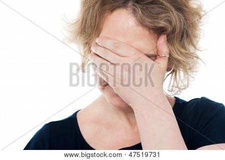 Unhappy Woman Hiding Her Face With Hand On It