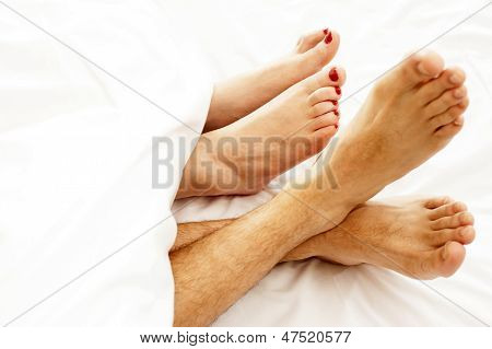 Closeup Of Bare Feet Of Love Couple, Making Out
