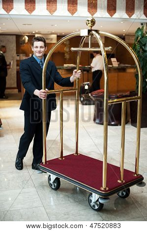 Casual Shot Of A Concierge Pushing The Cart