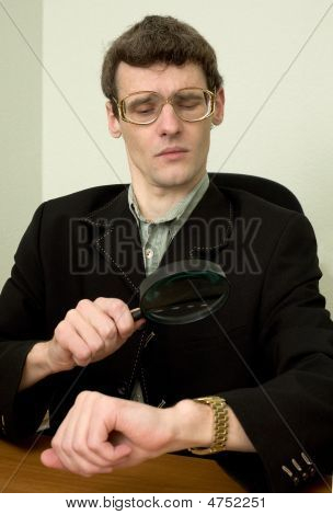 Person View A Watch Through A Magnifier