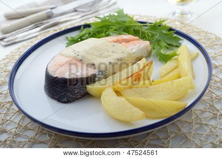 Baked salmon with potato, mustard sauce, and mizuna