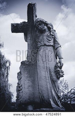 Angel Leaning On Cross