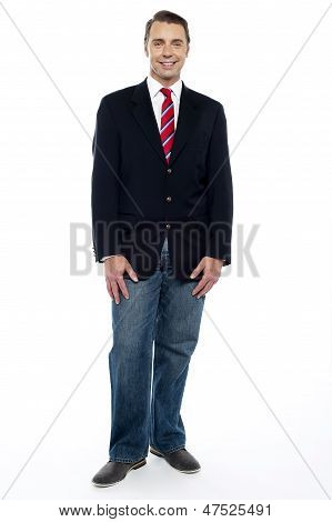 Ful Length Portrait Of Young Businessman In Jeans