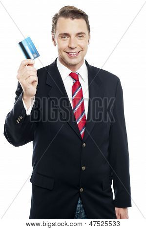 An Entrepreneur Showing Debit Card To Camera