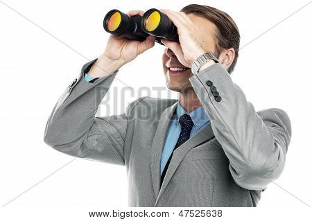 Businessman Viewing Through Binoculars