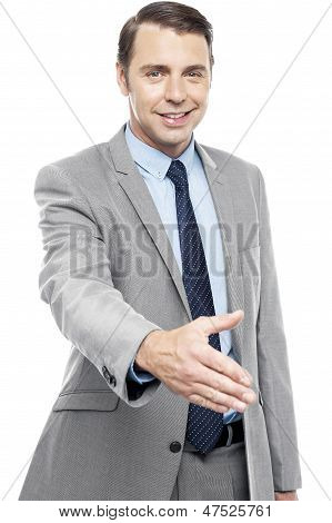 Executive Welcoming You With A Handshake