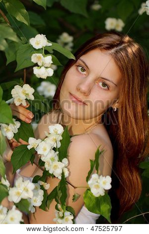 Beautiful Young Girl In The Garden