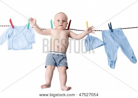 Little Baby Boy Hanging On A Clothesline, Drying On Clothespins On Rope After Laundry Isolated On Wh
