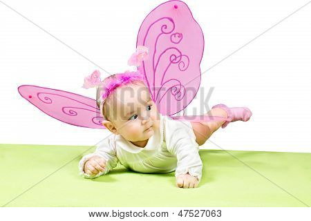 Pretty Child Girl, Dressed In Butterfly Costume On Green Background The Concept Of Childhood And Hol