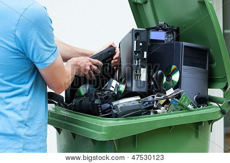 Man Discarding Old Electronics