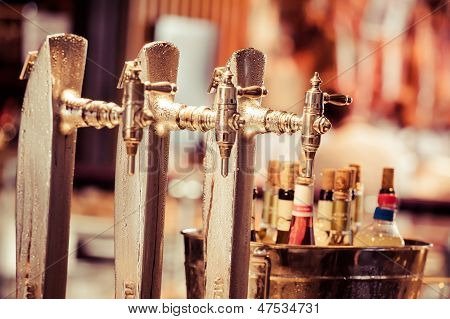 Glass Of Beer On Pub Over Blurred  Background
