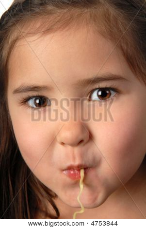 Young Girl Slurping A Noodle