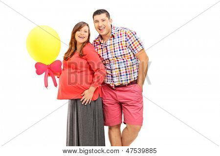 Happy couple expecting a baby and holding a balloon isolated on white background