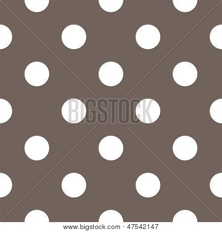 Seamless vector pattern with big white polka dots on a dark brown background.