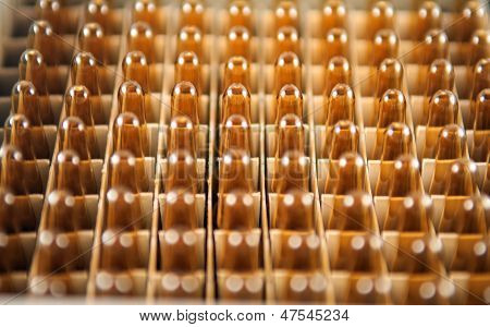 Closed Up Brown Ampule In Box