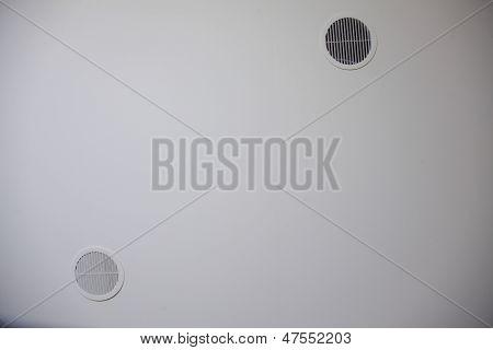 Circular Plastic Air Vent In White Wall