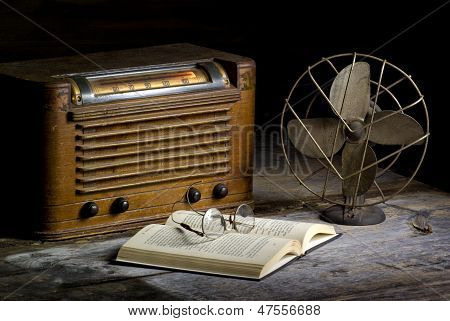 vintage radio and fan on primitive desk