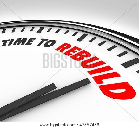 A clock with the words Time to Rebuild to illustrate the need to start fresh with a new beginning, to overall your life and change your prospects and improve for success