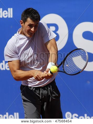 BARCELONA - APRIL, 23: Australian tennis player Bernard Tomic in action during his match against Kenny de Schepper of Barcelona tennis tournament Conde de Godo on April 23, 2013 in Barcelona