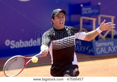BARCELONA - APRIL, 23: Argentinian tennis player Carlos Berlocq in action during a match of Barcelona tennis tournament Conde de Godo on April 23, 2013 in Barcelona