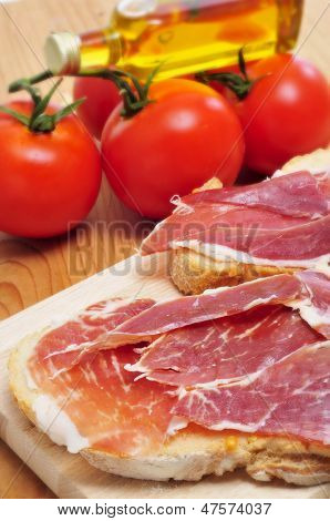 closeup of spanish pa amb tomaquet, bread with tomato, with serrano ham