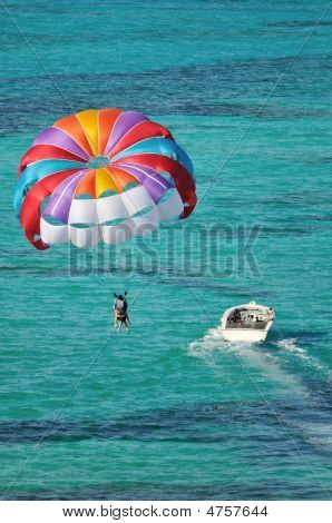 Parasailing Over The Caribbean Ocean