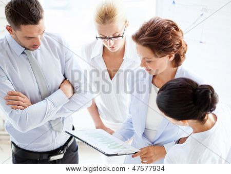 friendly business team having discussion in office
