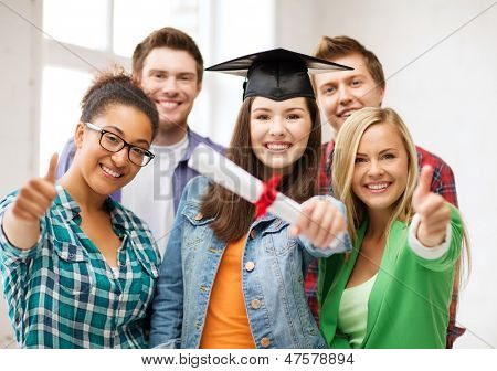 education - happy girl in graduation cap with certificate and students