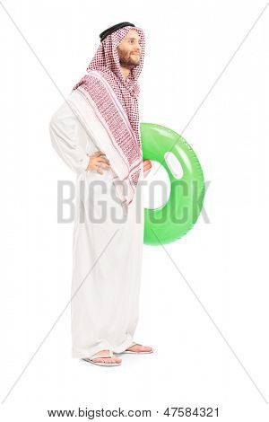 Full length portrait of a male arab person holding a swimming ring isolated on white background
