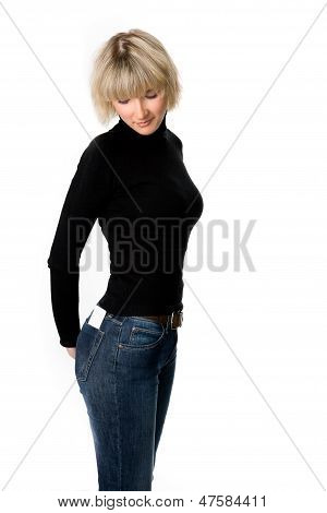 Girl Looks At An Empty Card In Her Back Pocket