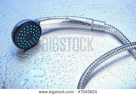 Shower and drops, on blue background