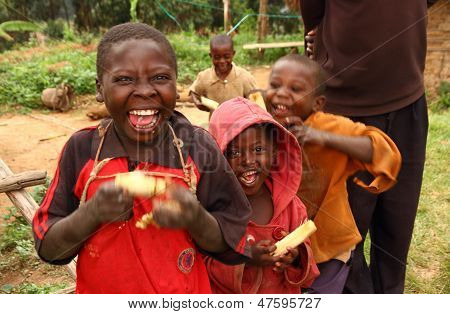 Happy Ugandan Children Eating Sugarcane