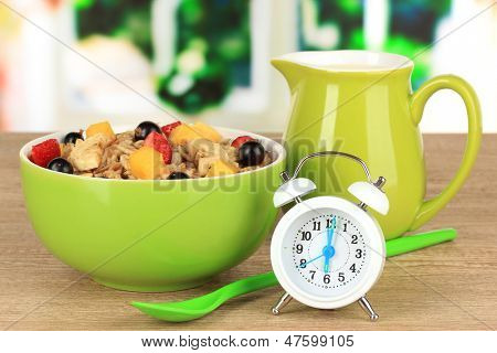 Oatmeal with fruits on table in kitchen