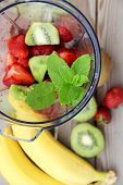 picture of blender  - Fresh vivid smoothie ingredients and blender on the wooden background - JPG
