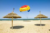 foto of parasailing  - Parasailing on the beach of the Mediterranean in Tunisia - JPG