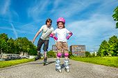 picture of roller-skating  - Father and daughter enjoy roller skating - JPG