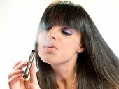 stock photo of substitutes  - brunette beautiful girl smoking a electronic cigarette - JPG
