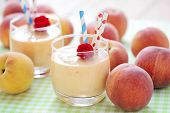 stock photo of cold drink  - delicious and fresh peach smoothie   - JPG