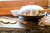 stock photo of chinese wok  - an old chinese wok in the kitchen - JPG