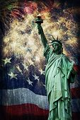 picture of statue liberty  - Composite photo of the statue of Liberty with a flag and fireworks in the background. Given a grunge overlay for a nice aged effect. Nice patriotic image for Independence Day 
