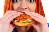 stock photo of burger  - woman eat burger on a white background - JPG