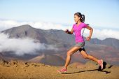 stock photo of cross  - Female running athlete - JPG