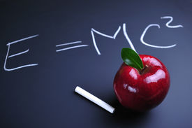 foto of einstein  - Red apple and Einstein relativity formula on blackboard - JPG