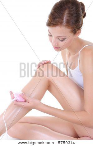 Beautiful Young Woman Shaving Her Legs