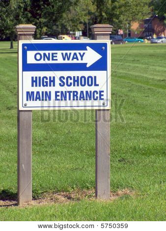 One way arrow high school sign