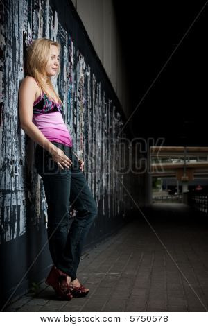 Smiling Young Woman Against Wall