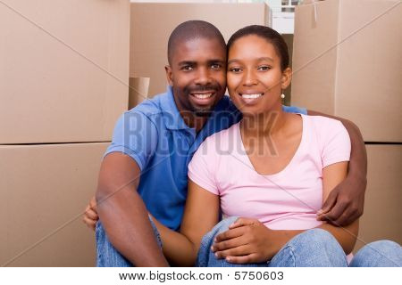couple hugging in new home
