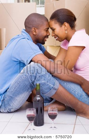 african american couple celebrate their new home