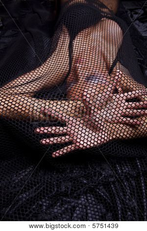 Woman Traped In Black Fishnet